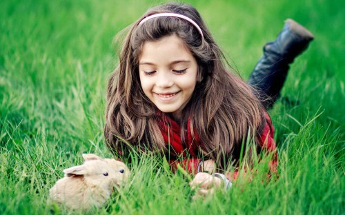 Happy-Girl-Playing-With-Rabbits-Wallpaper